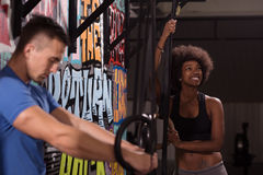 Portrait of multiethnic couple  after workout at gym Stock Photos