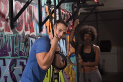 Portrait of multiethnic couple  after workout at gym Stock Image
