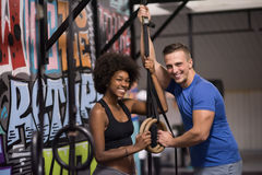 Portrait of multiethnic couple  after workout at gym Stock Photo