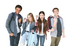 portrait of multiethnic group of excited students with backpacks stock photo