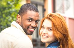Portrait of multiethnic man and young woman walking outdoors - H Royalty Free Stock Image