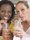 Portrait Of Multiethnic Women Drinking Milkshake Royalty Free Stock Photography