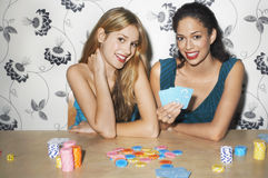 Portrait Of Multiethnic Women Playing Cards Stock Images