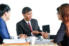 Portrait Multiracial Businesspeople Brainstorming In Meeting Stock Photos