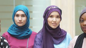 Portrait of multiracial group of muslim women dressed in national dresses posing in shopping centre. Portrait of multiracial group of muslim women dressed in stock video