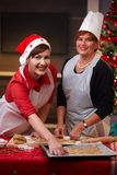 Portrait of mum and daughter at christmas baking Stock Image