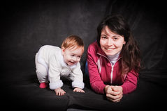 Portrait of mum with a little baby Stock Images