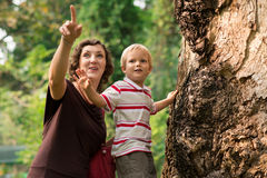 Dear, look there!. Portrait of a mum and a son in the zoo royalty free stock photography
