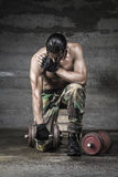 Portrait of muscle athlete. With camouflage pants weightlifting Royalty Free Stock Photos