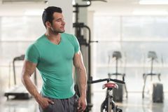 Portrait of Muscle Man in Green T-shirt Stock Photography