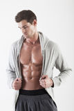 Portrait of a muscle man posing. Isolated stock photo