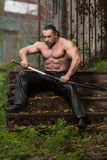 Portrait Of A Muscular Ancient Warrior With Sword Royalty Free Stock Images