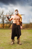 Portrait of a muscular ancient warrior with a sword Royalty Free Stock Image