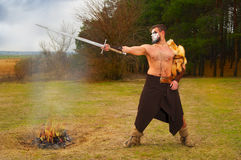 Portrait of a muscular ancient warrior with a sword Royalty Free Stock Photo