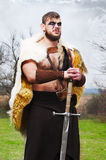 Portrait of a muscular ancient warrior with a sword Royalty Free Stock Photos