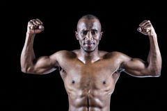 Portrait of muscular athlete posing Stock Photo