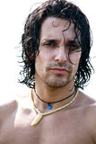 Portrait of muscular male model on the beach. Fashion model male on the beach looking into camera intense Stock Images