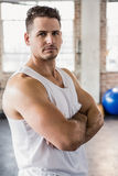Portrait of a muscular man with arms crossed Royalty Free Stock Photo