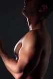 Portrait muscular man on black background Stock Image