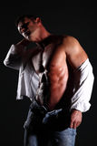 Portrait muscular man on black background Royalty Free Stock Images