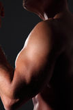 Portrait muscular man on black background Stock Photography