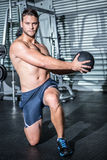 Portrait of muscular man doing exercise with medicine ball Stock Images