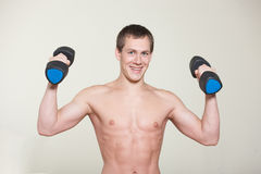 Portrait of muscular man with dumbbells in hand Royalty Free Stock Photos