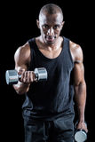 Portrait of muscular man exercising with dumbbell Stock Photo