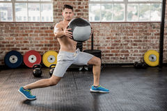 Portrait of muscular man exercising with medicine ball Royalty Free Stock Image