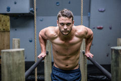 Portrait of muscular man exercising on parallel bars Royalty Free Stock Photography