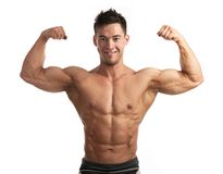 Portrait of muscular man flexing his biceps Royalty Free Stock Photography