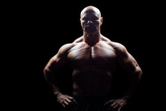 Portrait of muscular man with hands on hip Royalty Free Stock Images