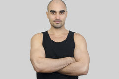Portrait of a muscular man. Handsome bald man with arms crossed. Stock Image