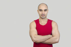 Portrait of a muscular man. Handsome bald man with arms crossed. Royalty Free Stock Photography