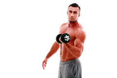 Portrait of muscular man lifting dumbbell Stock Photography
