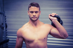 Portrait of muscular man lifting a kettlebell Stock Image