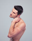 Portrait of a muscular man with neck pain Royalty Free Stock Images