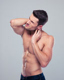 Portrait of a muscular man with neck pain Royalty Free Stock Photography