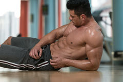 Portrait Of A Muscular Man Relaxing In Gym Stock Photo