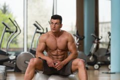 Portrait Of A Muscular Man Relaxing In Gym Stock Image