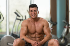 Portrait Of A Muscular Man Relaxing In Gym Royalty Free Stock Images