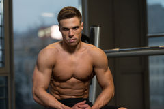 Portrait Of A Muscular Man Relaxing In Gym Royalty Free Stock Image