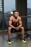 Portrait Of A Muscular Man Relaxing In Gym Royalty Free Stock Photography
