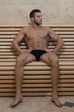 Portrait Of A Muscular Man Relaxing In Sauna Royalty Free Stock Images