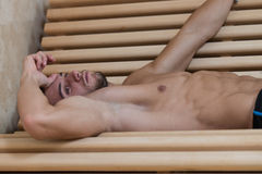 Portrait Of A Muscular Man Relaxing In Sauna Royalty Free Stock Photo