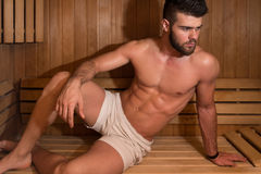 Portrait Of A Muscular Man Relaxing In Sauna Royalty Free Stock Photos