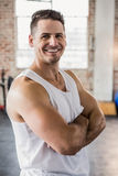 Portrait of a muscular man smiling with arms crossed Royalty Free Stock Photos