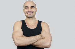 Portrait of a muscular man smiling. Handsome bald man with arms crossed. Royalty Free Stock Photos
