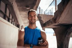 Athlete taking a break after workout session Stock Image