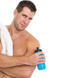 Portrait of muscular man with towel and bottle Stock Images